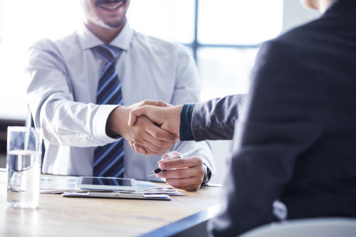 buy a business | people conducting a negotiation